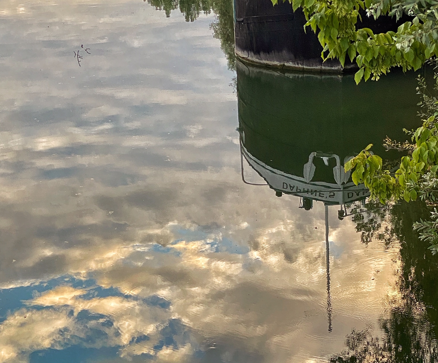 Reflections of the Péniche Daphne's in the Oise